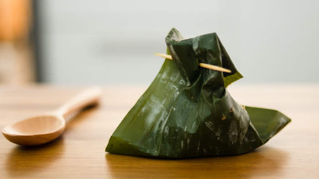fish floss and sticky rice wrapped in banana leaves photo