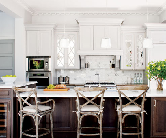 classic kitchen with white upper cabinets + darker wood island