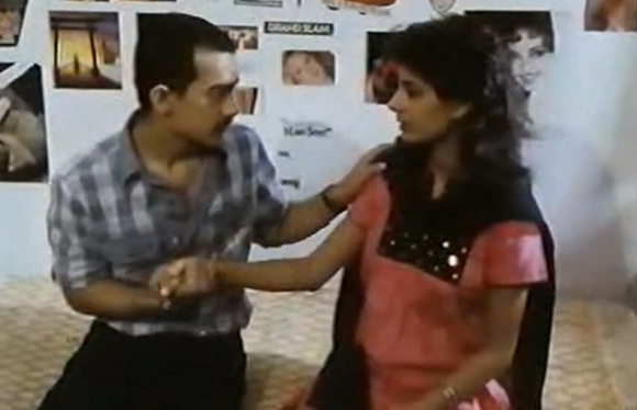 A video showing a scene from Holi, in which Aamir Khan kisses Kitu Gidwani is buzzing around.  It shows an apprehensive Aamir Khan making a nervous lip contact, which was a big deal in a 1984 film, with Kitu Gidwani.  She went on to become a popular model  and Aamir Khan got a huge break in Qayamat Se Qayamat Tak four years later.