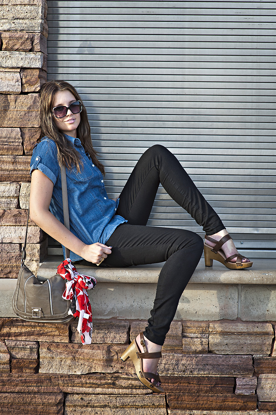 Sunglasses, brown purse, brown heels