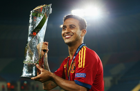Spain player Thiago poses with the trophy after winning the European U-21 Championship final