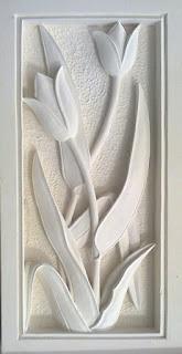 Relief batu alam paras jogja motif bunga tulip