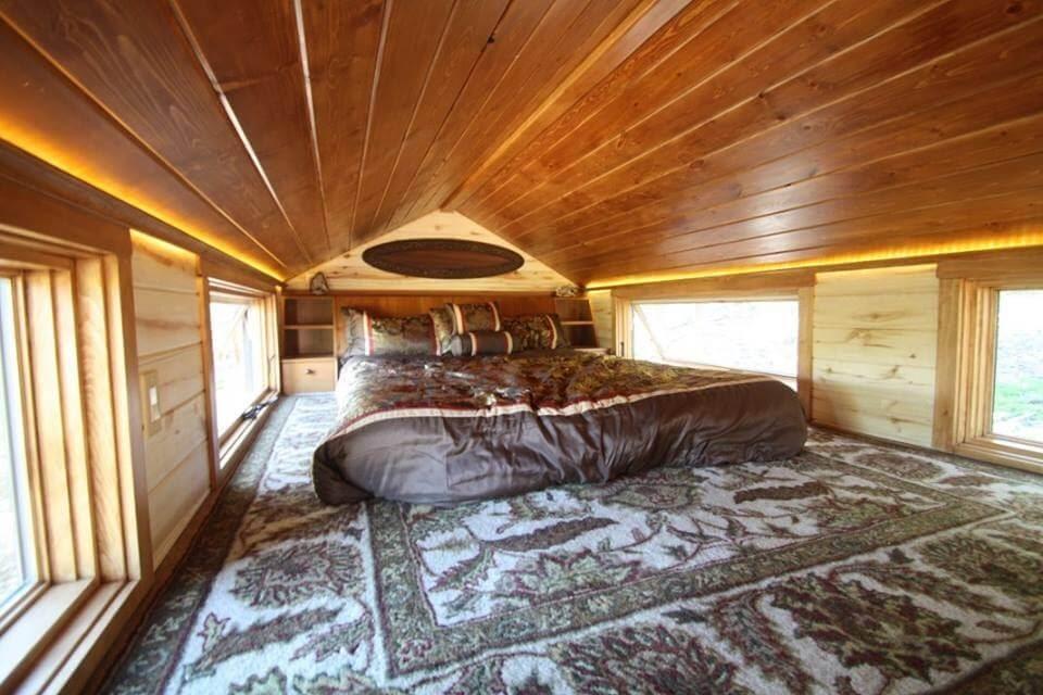 13-Master-Bedroom-Simblissity-Tiny-House-Stone-Cottage-on-Wheels-www-designstack-co