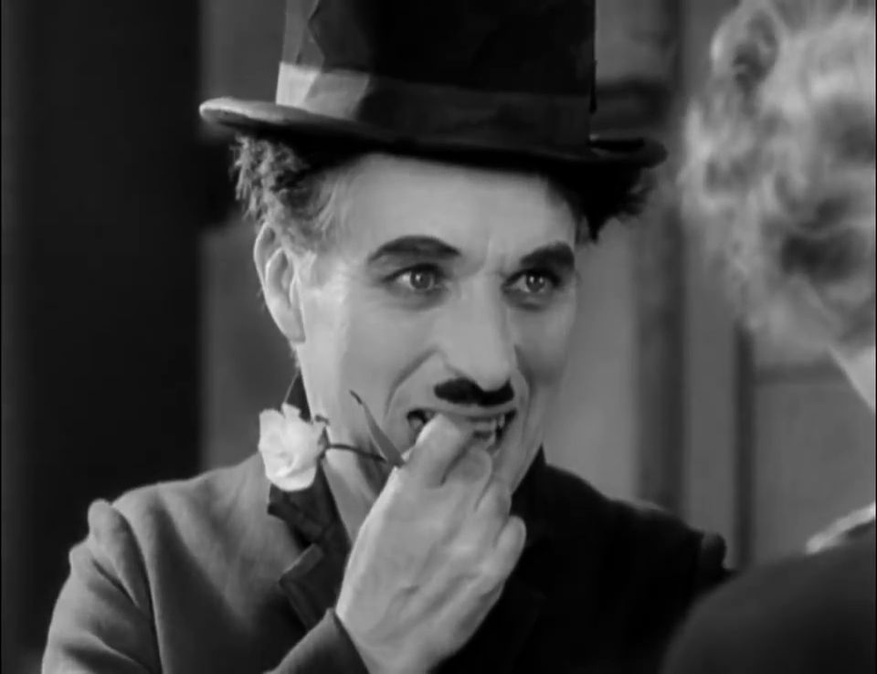 An analysis of charlie chaplin character in the movie city lights
