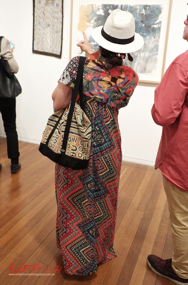 Heavy tribal pattern use in reds,  Dress, tote bag, floral scarf. Street Fashion Sydney.