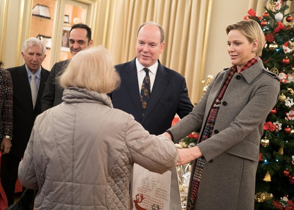 Princess Charlene wore Louis Vuitton wool coat. Rosine Sanmori Nursery / Day Care Centre in Fontvieille. Christmas gifts