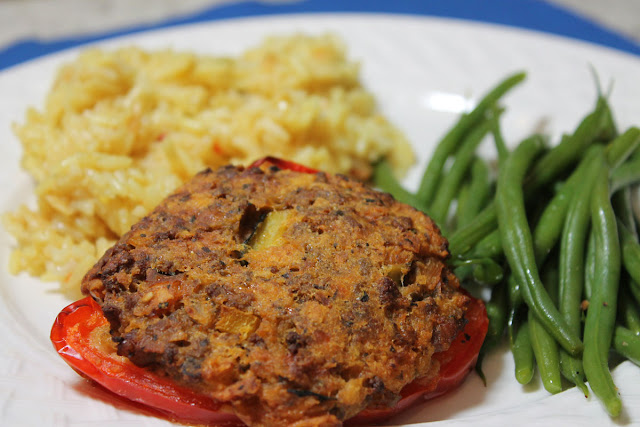 Ground beef, hot sausage and vegetables make the filling for this stuffed pepper.