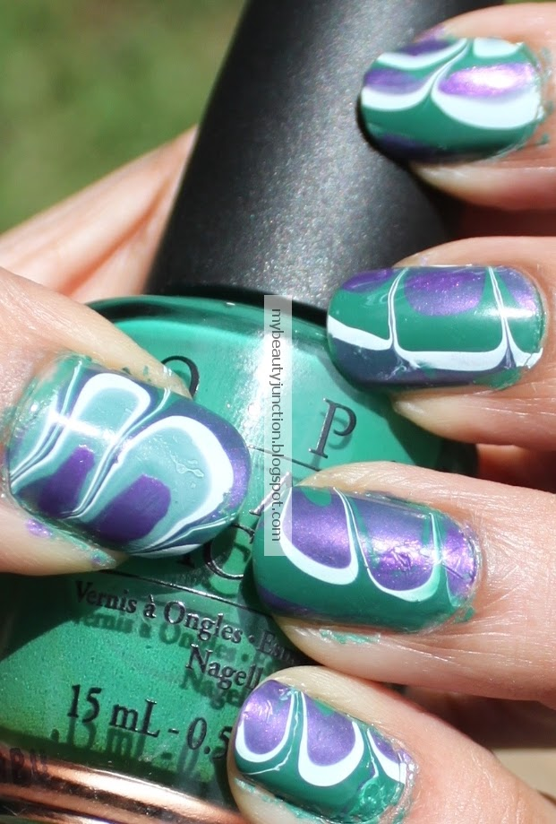Water marbling nail art with O.P.I. polishes and tips and pointers