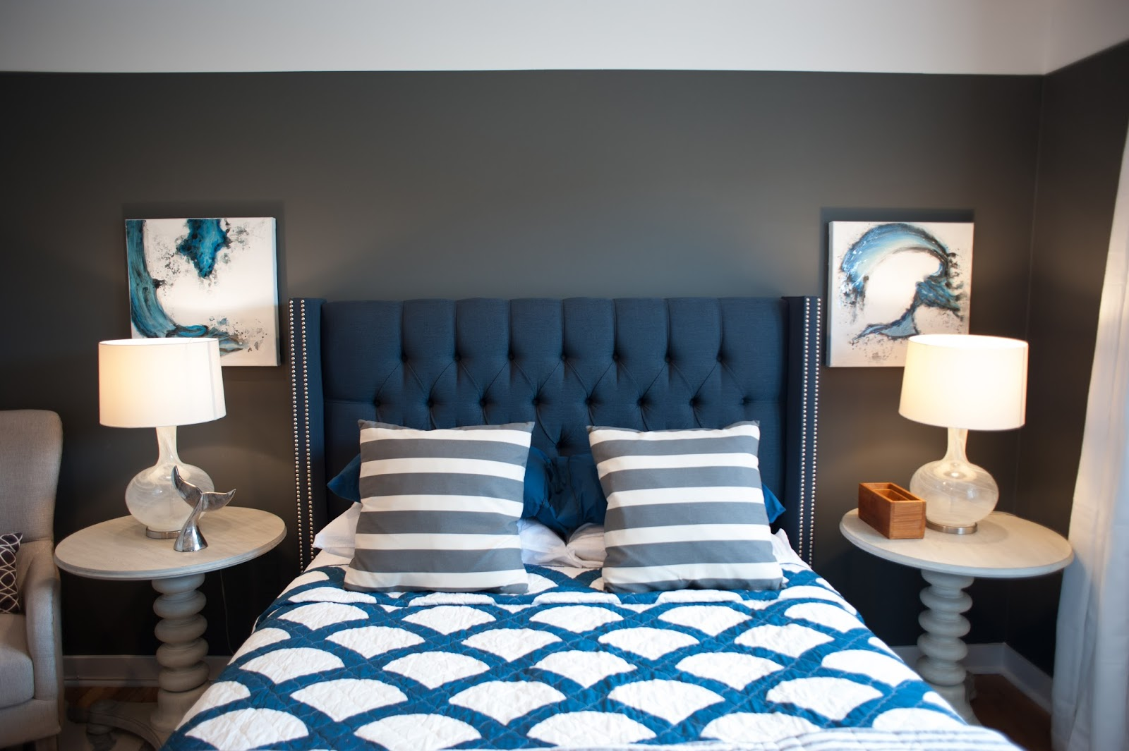 Blue headboard in beachy bedroom