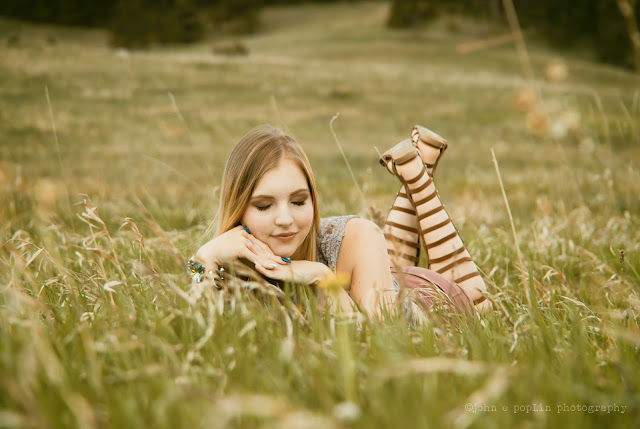 a young girl poses in a meadow at Boulder's Chautauqua Park