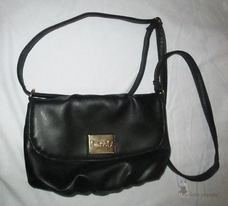 http://www.passarela.com.br/feminino/produto/6351192312/Bolsa-Transv-Dariely-3825----Preto/