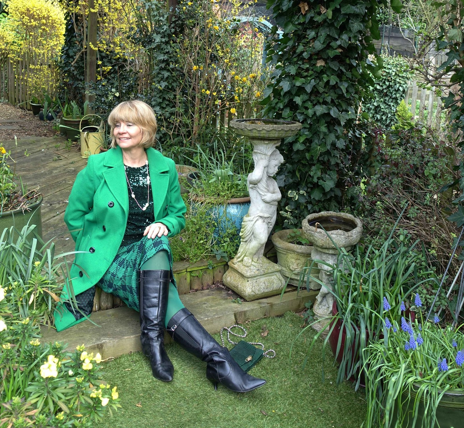 Over 50s blogger Gail Hanlon wearing an all-green outfit including sequin top and wool coat for St Patrick's Day 2019