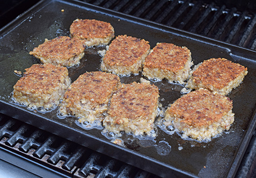 The Char-Broil Commercial 4 burner grill comes with this cast iron plate for use on the side burner, but I used it on the grates just fine.