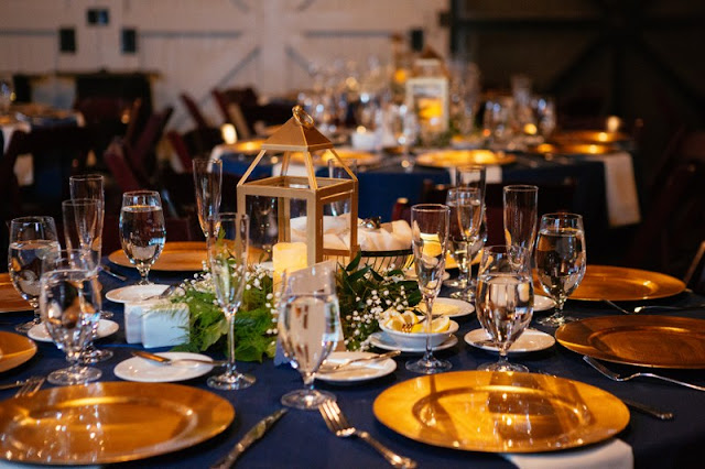 navy and gold table setting at reception