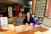 Teens doing money puzzle at Olney