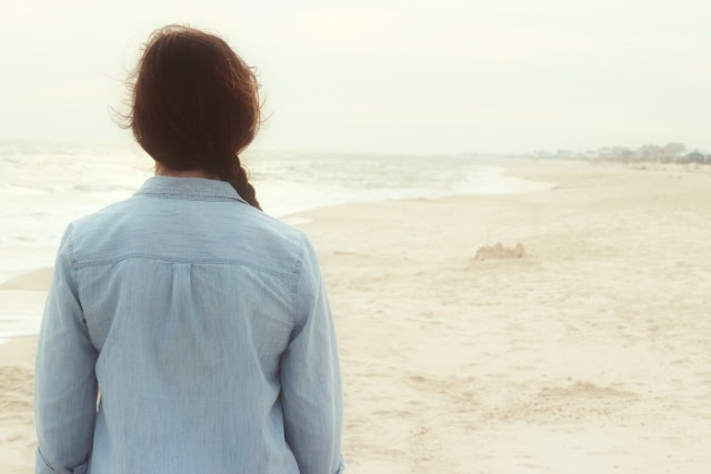 Surprise Yourself - Start Blogging | Morgan's Milieu: A woman staring out at the sea.