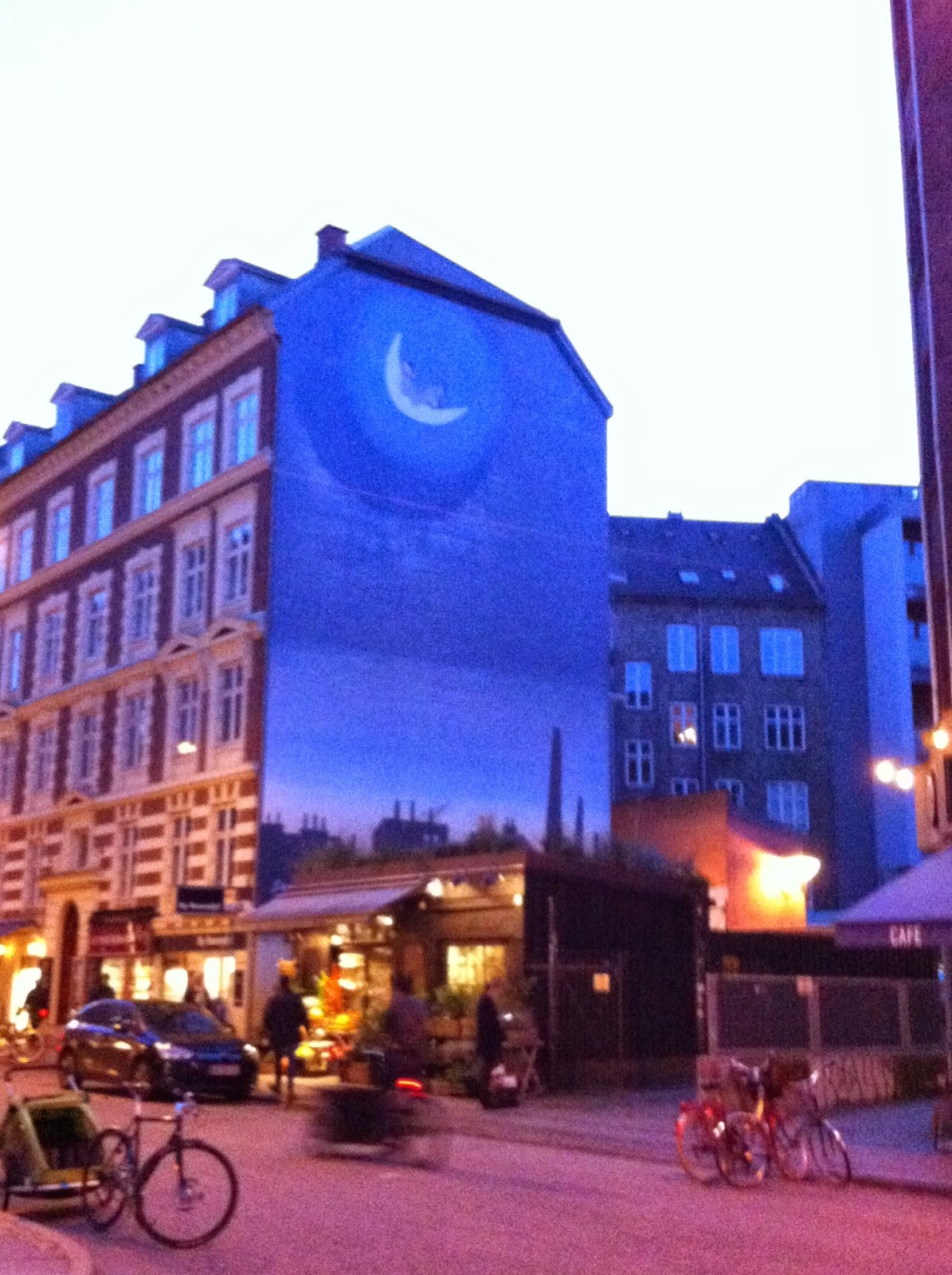 a moon and city painting on the side of a building in Copenhagen