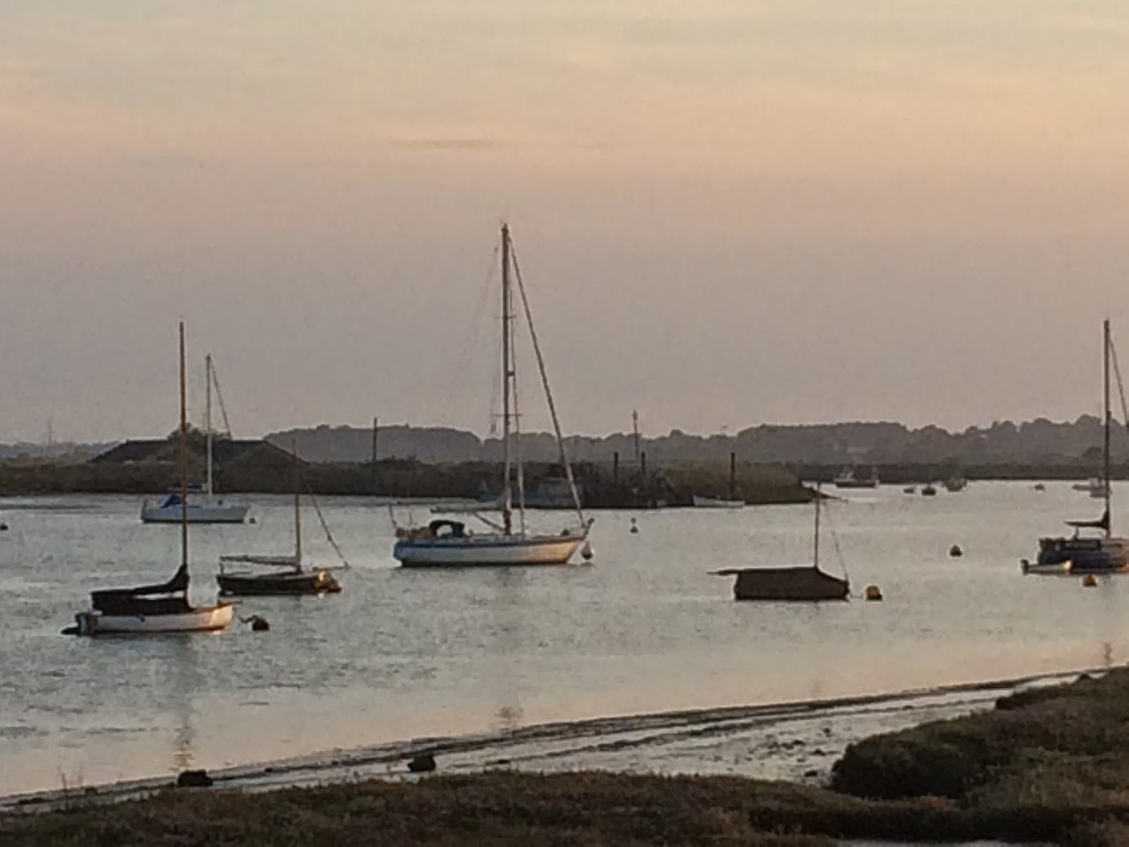 boats at sunset in Orford, Suffolk