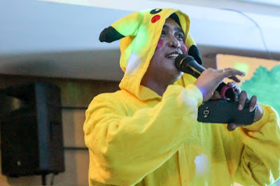 Halloween Party Host in a Pikachu Outfit