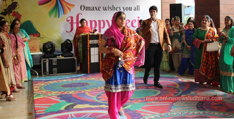 A resident walks on ramp during Teej celebrations at Omaxe Royal Residency