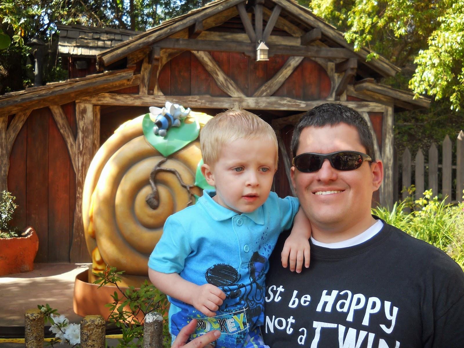 Little kids enjoy Winnie the Pooh and other rides at Disneyland. LoveOurDisney.com
