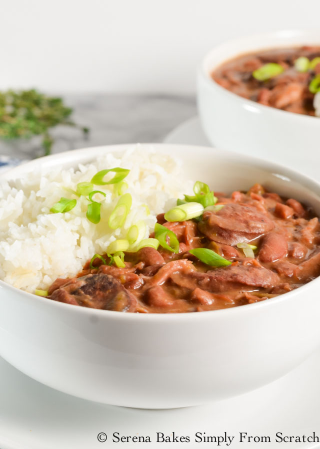 Meaty Red Beans and Rice recipe with ham hock and andouille sausage is a favorite for dinner from Serena Bakes Simply From Scratch.