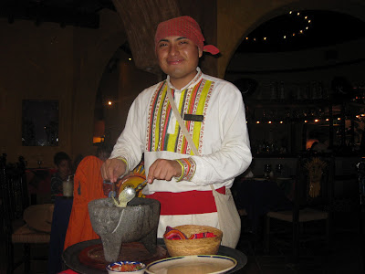 Waiter in traditional Mexican outfit in restaurant