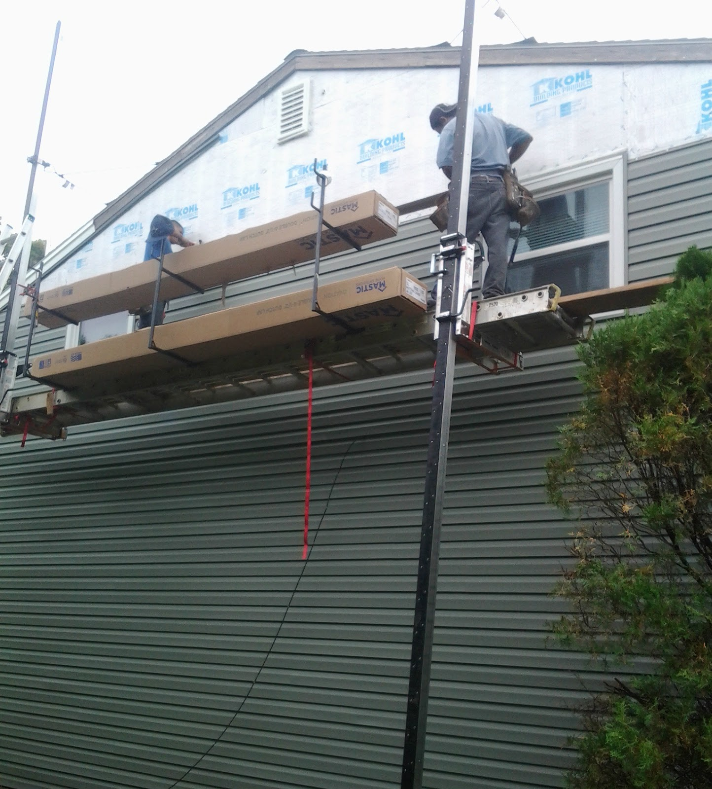 Jp construction services tyvek vs exterior insulation or - Exterior house insulation under siding ...