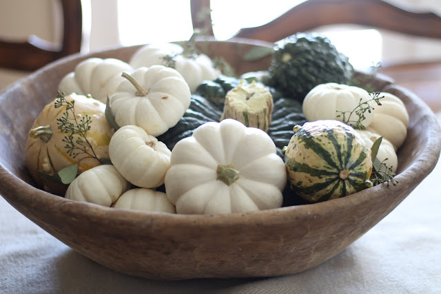 fall home tour antique dough bowl filled with white baby pumpkins and gourds and eucalyptus