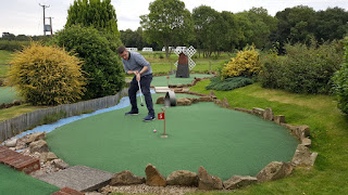 Playing hole 5 of the 11-hole Crazy Golf course at York Golf Range in Towthorpe near Strensall earlier this year. The course was #764 on our travels