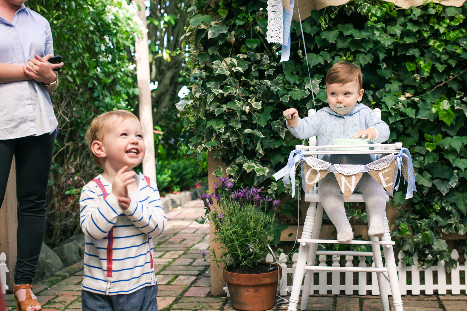 Cake smash in Vintage high chair and bunting for babys Peter Rabbit themed first birthday