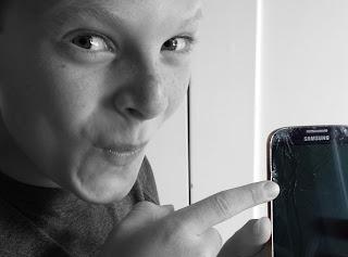 Teen Pointing to Broken Phone