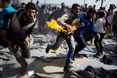Photos: Migrant Filmed Setting Himself On Fire In Protest At Refugee Camp