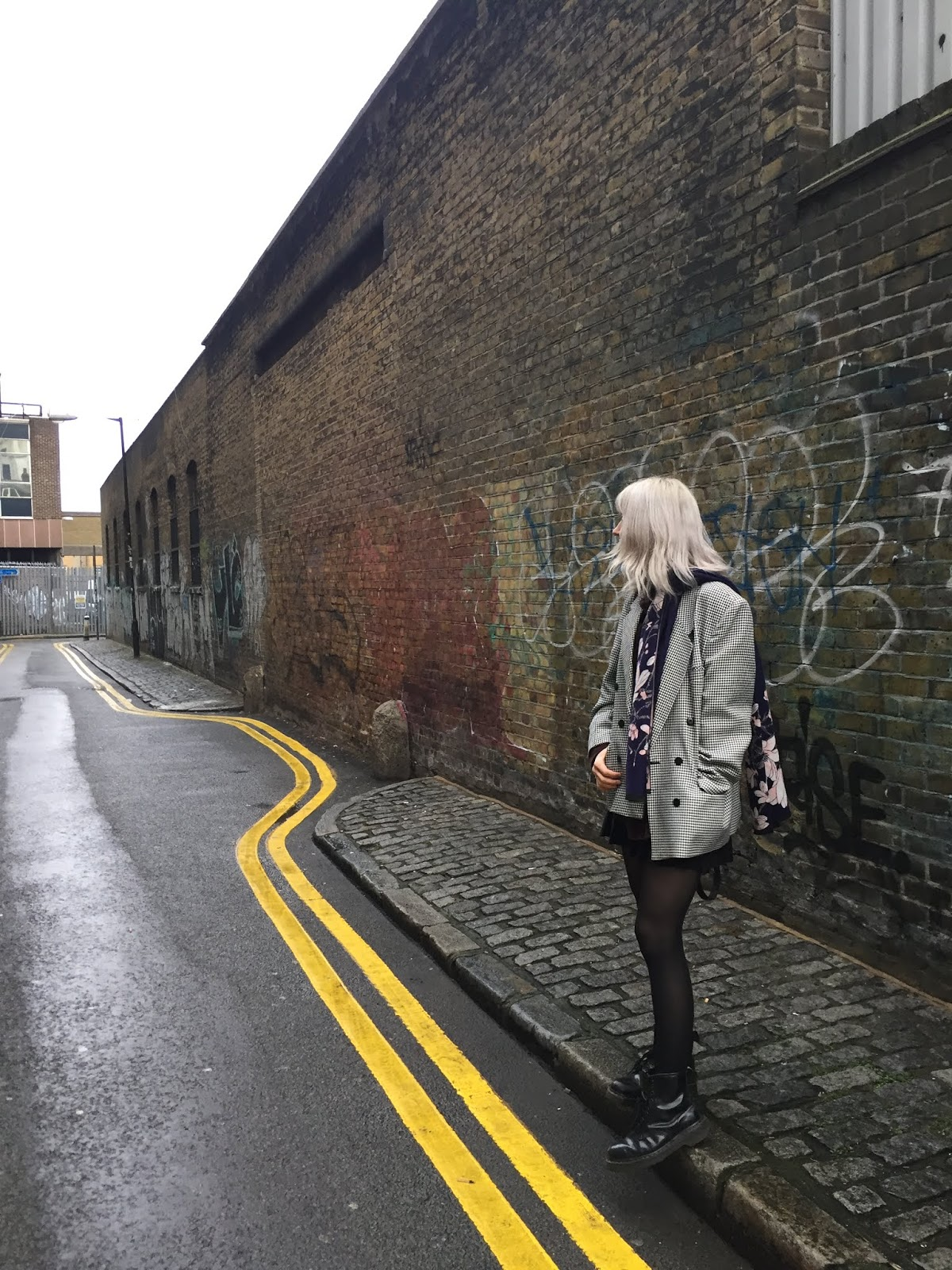 Silver haired girl wearing houndstooth blazer and dr martens