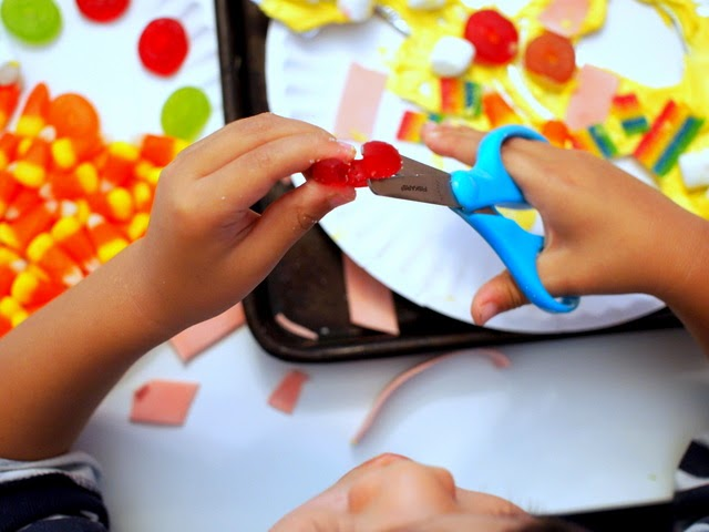 cutting candy with scissors to create candy kids art