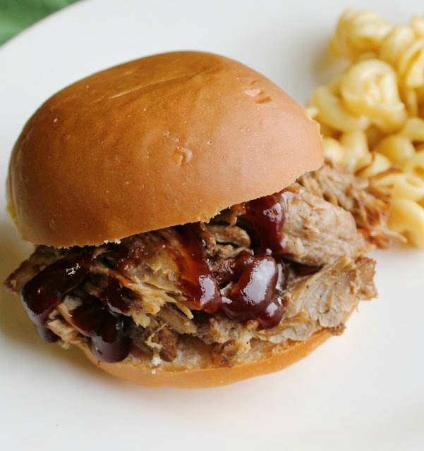 close up of a pulled pork sandwich with bbq sauce