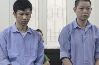 Ta Anh Tuan (R) and Nguyen Hong Quan