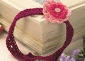 http://www.letsknit.co.uk/free-knitting-patterns/girls_crocheted_flower_headband