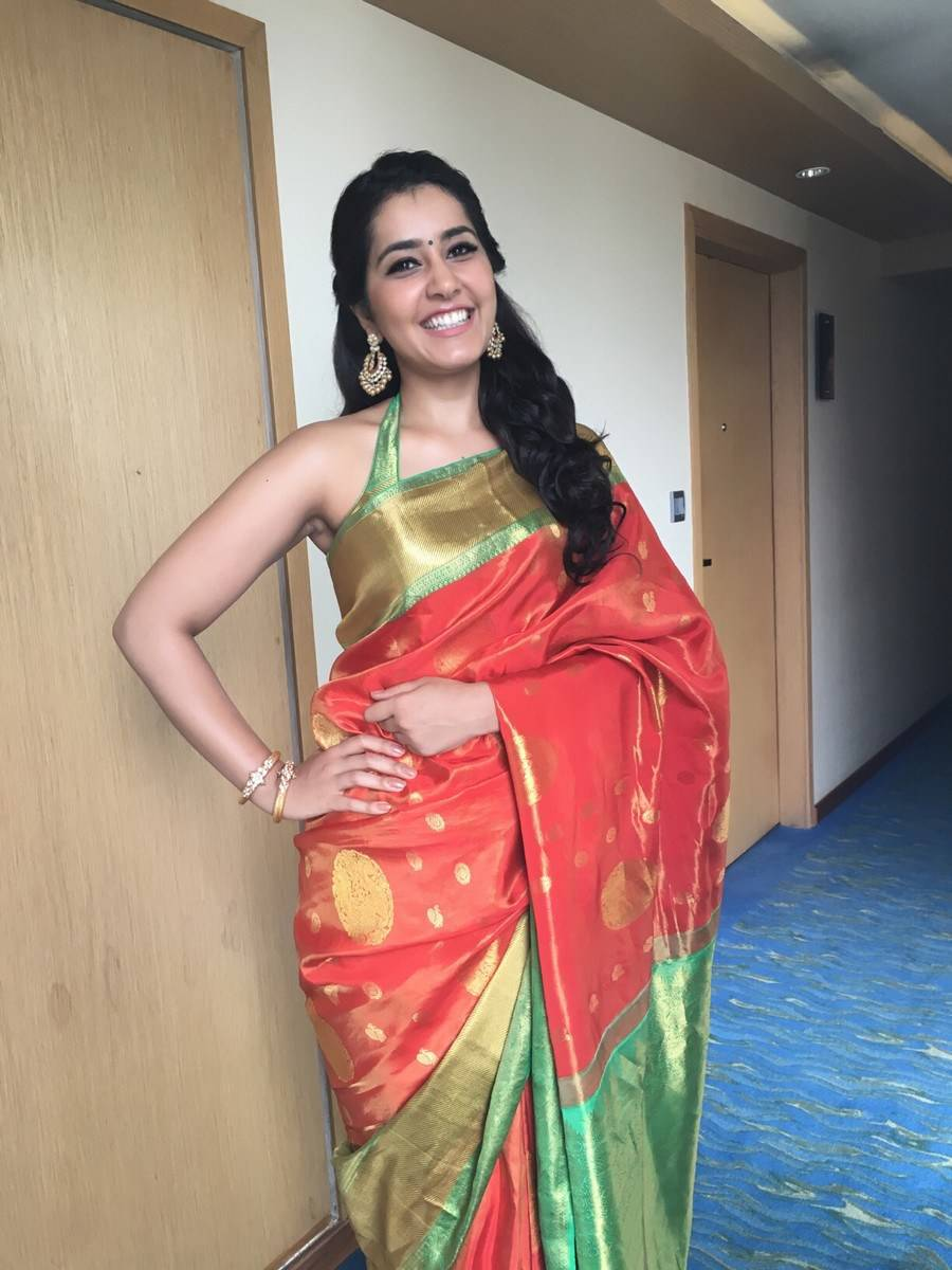 Rashi Khanna Stills At Store Launch In Hot Traditional Orange Saree