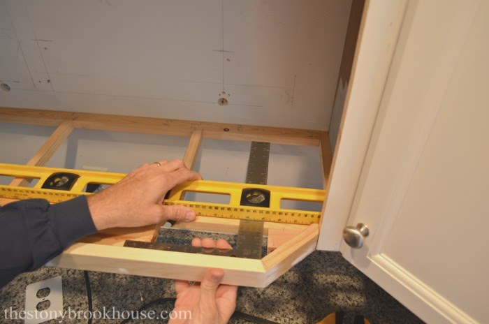 Measuring for base of microwave shelf