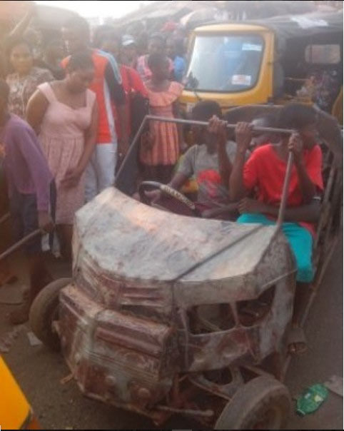 Photos: Crowd gather as teenager produces vehicle in Enugu