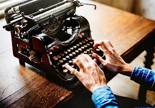 This is a photo of old hands typing on an old typewriter.  Used to relate to the taking notes topic