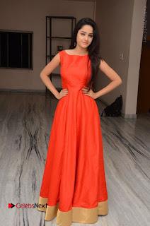 Telugu Actress Divya Nandini Stills in Orange Sleeveless Gown at Chennai Chaitrama Movie le Launch Event  0122.JPG