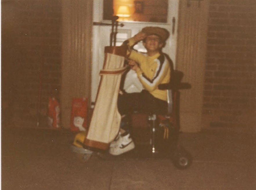 Me around 12, dressed as a golfer, in my Amigo, with a golf bag