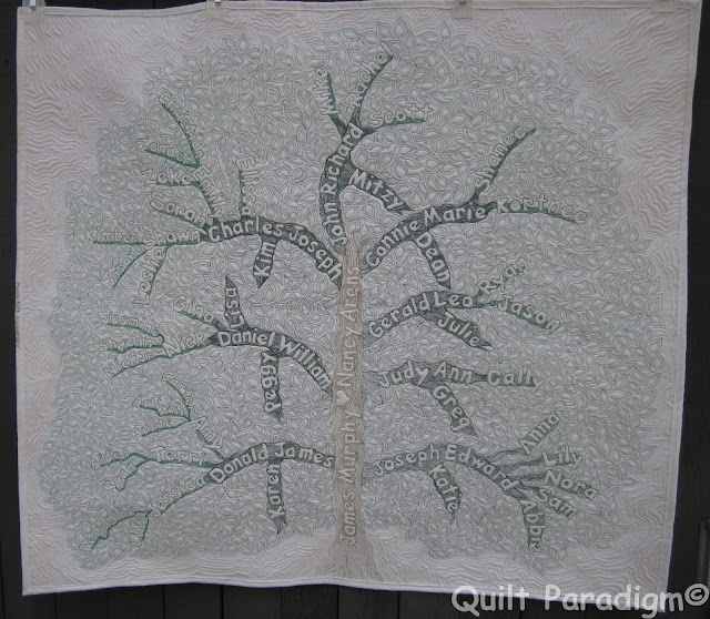 http://quiltparadigm.blogspot.com/2015/08/family-tree-quilt-finished-for-reals.html
