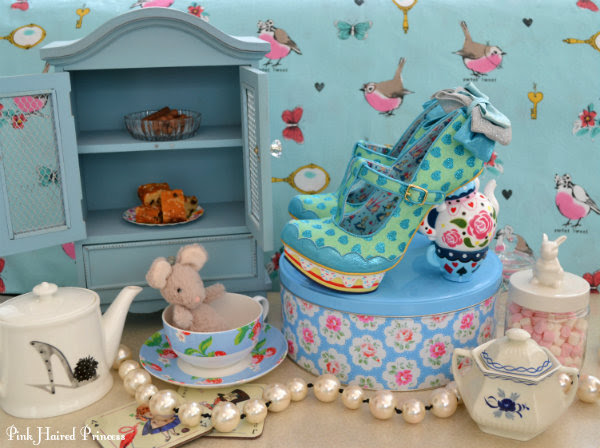 vintage tea party scene with teapot cakes dormouse and Irregular Choice Alice shoes