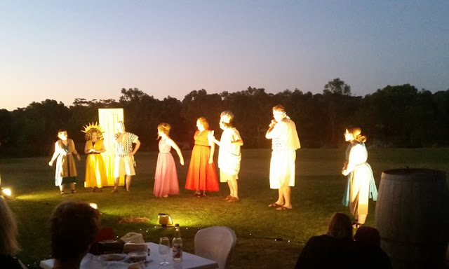 Spotlights on the performers. Eight actors in costume perform a final scene.