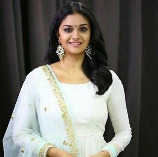 Keerthy Suresh in White Dress Dress with Cute and Awesome Lovely Chubby Cheeks Smile