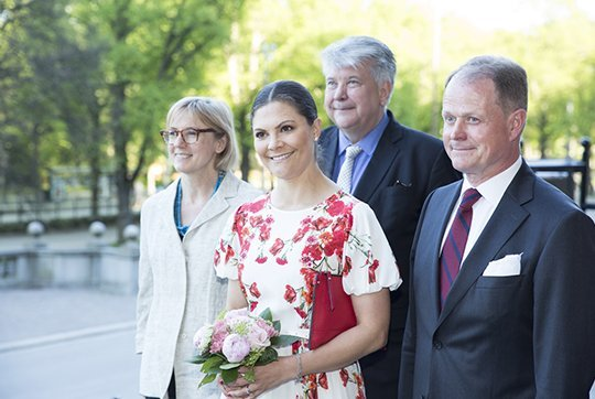 Crown Princess Victoria wore CAMILLA THULIN Alvine Rose White Dress, and Princess Victoria wore Rizzo red shoes and carried a red Rizzo clutch