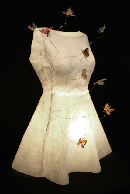 lighted paper dress with butterflies attached on wires